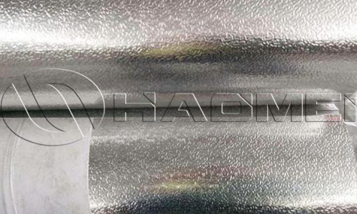 Stucco embossed aluminum cladding sheet
